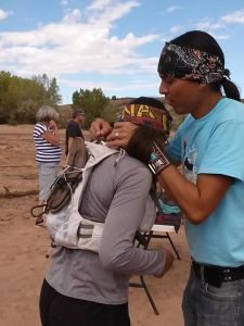 Receiving my beautiful hand-beaded turquoise finishers necklace from race director Shaun Martin. Photo credit: Rina Tapia