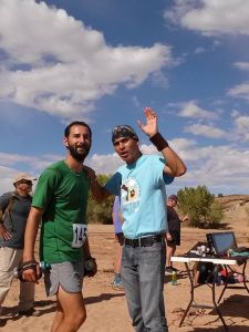 Bobby receiving his necklace and being directed towards the stew & frybread. Photo credit: Rina Tapia
